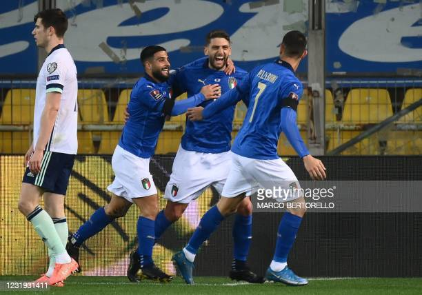 Italy's forward Domenico Berardi celebrates after opening the scoring during the FIFA World Cup Qatar 2022 Group C qualification football match...