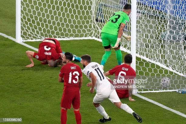 Italy's forward Domenico Berardi celebrates Turkey's defender Merih Demiral's owngoal during the UEFA EURO 2020 Group A football match between Turkey...