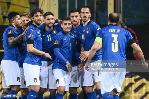 Italy's forward Domenico Berardi celebrates with teammates after opening the scoring during the FIFA World Cup Qatar 2022 Group C qualification...