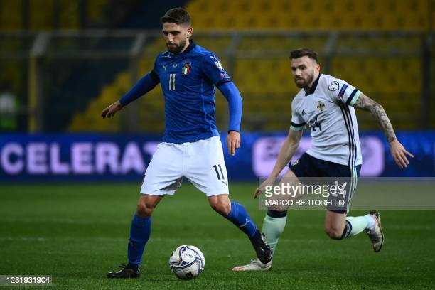 Italy's forward Domenico Berardi outruns Northern Ireland's defender Stuart Dallas during the FIFA World Cup Qatar 2022 Group C qualification...