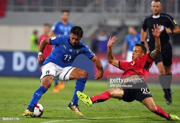 Italy's forward Eder vies with Albania's midfielder Ergys Kace during the FIFA World Cup 2018 qualification football match between Albania and Italy...