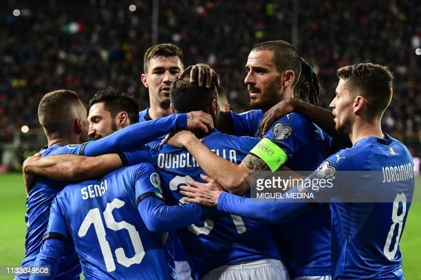 TOPSHOT Italy's forward Fabio Quagliarella celebrates with teammates after scoring a penalty during the Euro 2020 Group J qualifying football match...