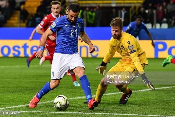 Italy's forward Fabio Quagliarella challenges Liechtenstein's goalkeeper Benjamin Buchel during the Euro 2020 Group J qualifying football match Italy...