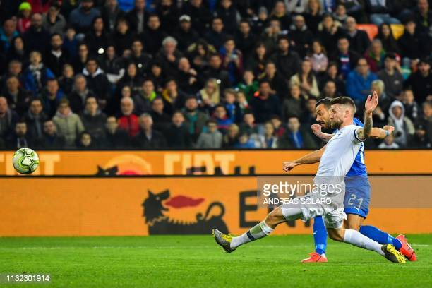 Italy's forward Fabio Quagliarella shoots on goal to hit the post despite Finland's defender Joona Toivio during the Euro 2020 Group J qualifying...