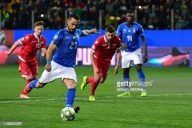 Italy's forward Fabio Quagliarella shoots to score a penalty during the Euro 2020 Group J qualifying football match Italy vs Liechtenstein on March...
