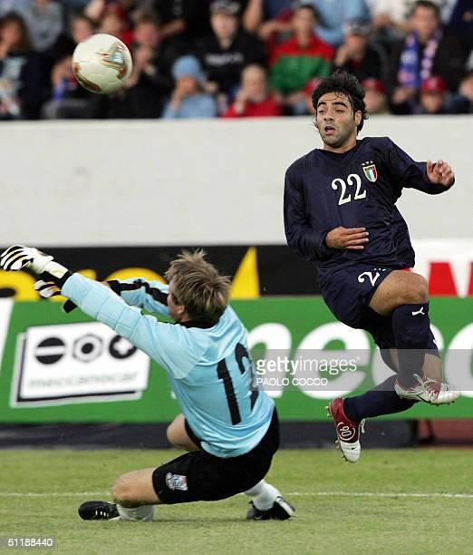 Italy's forward Fabrizio Miccoli challenges Iceland's goalkeeper Arni Gautur Arason during their international friendly football match at...