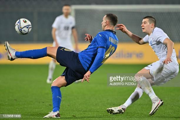 Italy's forward Federico Bernardeschi controls the ball under pressure from Estonia's defender Artur Pikk during the friendly soccer match Italy vs...