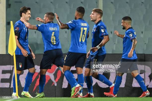 Italy's forward Federico Chiesa celebrates with teammates after scoring a goal during the FIFA World Cup Qatar 2022 qualifying round Group C football...