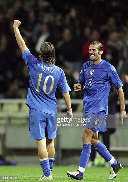 Italy's forward Francesco Totti celebrates the third goal against Belarus as teammate Giuseppe Pancaro looks on during their World Cup 2006...