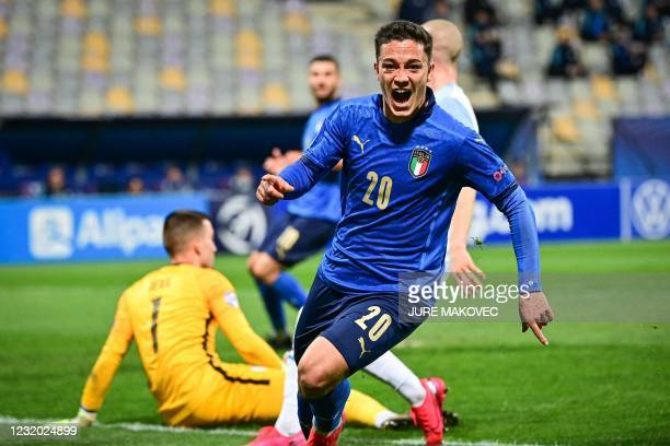 Italy's forward Giacomo Raspadori celebrates after scoring during the 2021 UEFA European Under-21 Championship Group B football match between Italy...