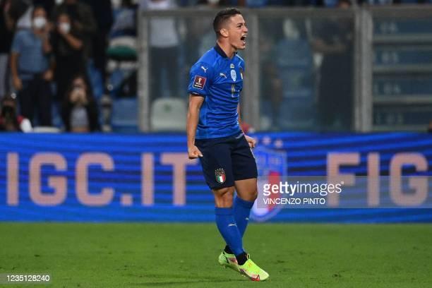 Italy's forward Giacomo Raspadori celebrates scoring his team's second goal during the FIFA World Cup Qatar 2022 Group C qualification football match...