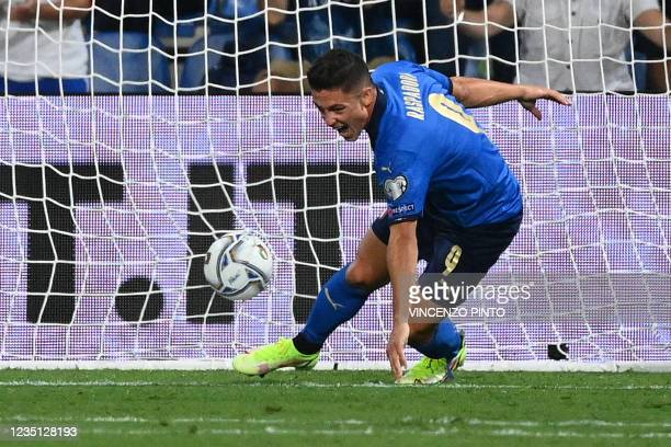 Italy's forward Giacomo Raspadori reacts after scoring his team's second goal during the FIFA World Cup Qatar 2022 Group C qualification football...