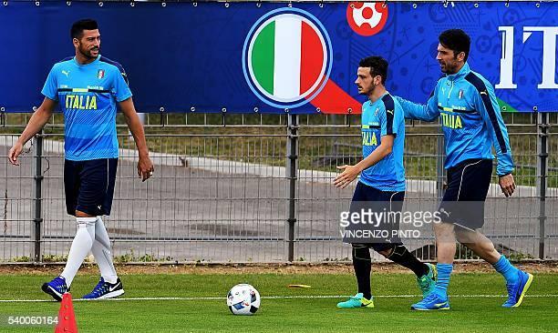 Italy's forward Graziano Pelle Italy's midfielder Alessandro Florenzi Italy's goalkeeper Gianluigi Buffon attend a training session in Montpellier on...