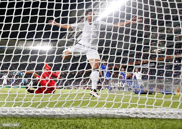 Italy's forward Graziano Pelle scores a goal during their World Cup 2018 qualification match between Israel and Italy at the Sammy Ofer Stadium in...