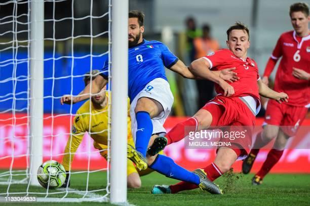 Italy's forward Leonardo Pavoletti scores despite Liechtenstein's defender Jens Hofer during the Euro 2020 Group J qualifying football match Italy vs...