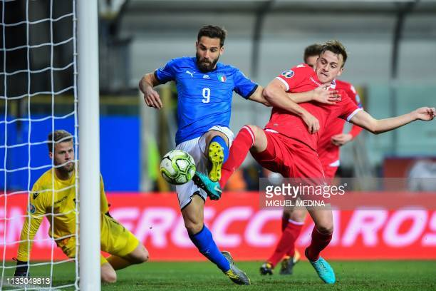 Italy's forward Leonardo Pavoletti scores during the Euro 2020 Group J qualifying football match Italy vs Liechtenstein on March 26 2019 at the...