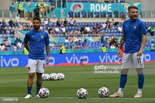 Italy's forward Lorenzo Insigne and Italy's forward Ciro Immobile warm up ahead of the UEFA EURO 2020 Group A football match between Italy and Wales...