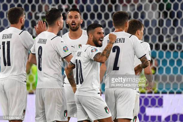 Italy's forward Lorenzo Insigne and teammates celebrate Turkey's owngoal scored by Turkey's defender Merih Demiral during the UEFA EURO 2020 Group A...