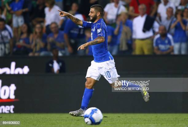 Italy's forward Lorenzo Insigne celebrates after scoring during the FIFA WC 2018 football qualification match between Italy and Liechtenstein at The...