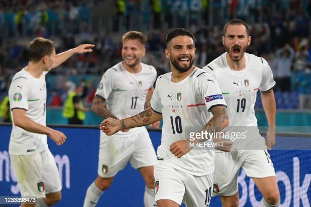 Italy's forward Lorenzo Insigne celebrates with teammates after scoring the team's third goal during the UEFA EURO 2020 Group A football match...