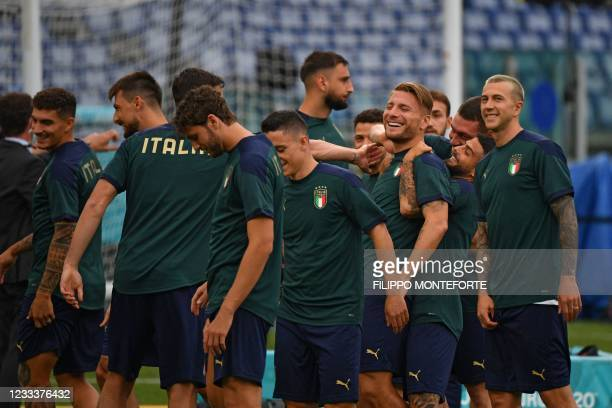 Italy's forward Lorenzo Insigne jokes with Italy's forward Ciro Immobile during a training session at the Olympic Stadium in Rome on June 10, 2021 on...