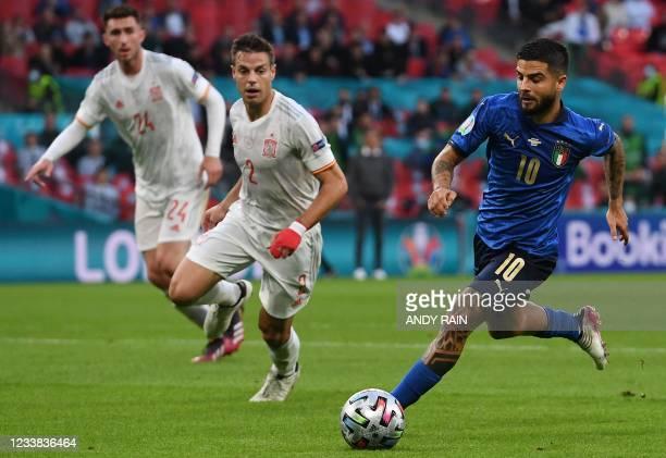 Italy's forward Lorenzo Insigne runs past Spain's defender Cesar Azpilicueta during the UEFA EURO 2020 semi-final football match between Italy and...