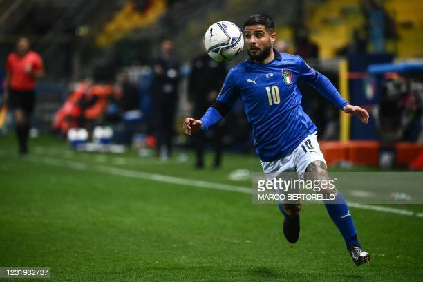 Italy's forward Lorenzo Insigne runs with the ball during the FIFA World Cup Qatar 2022 Group C qualification football match between Italy and...