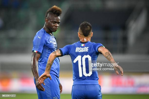 Italy's forward Mario Balotelli celebrates with Italy's forward Lorenzo Insigne after scoring his team's first goal during the friendly football...
