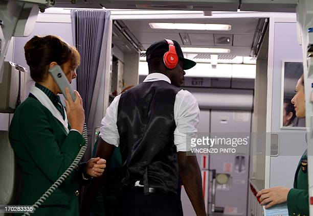 Italy's forward Mario Balotelli leaves the plane upon his arrival at Rio de Janeiro Galeao International airport on June 10 2013 AFP PHOTO / VINCENZO...