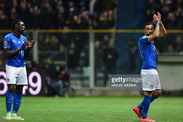 Italy's forward Moise Kean applauds Italy's forward Fabio Quagliarella as he leaves the pitch during the Euro 2020 Group J qualifying football match...