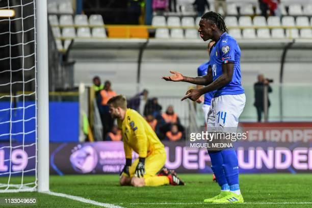 Italy's forward Moise Kean celebrates after scoring a header past Liechtenstein's goalkeeper Benjamin Buchel during the Euro 2020 Group J qualifying...