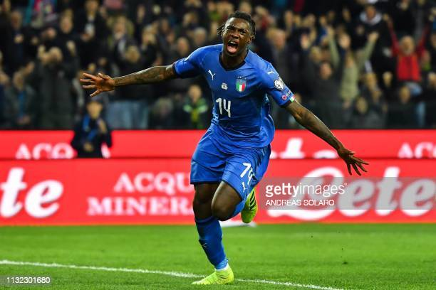 Italy's forward Moise Kean celebrates after scoring during the Euro 2020 Group J qualifying football match between Italy and Finland on March 23 2019...