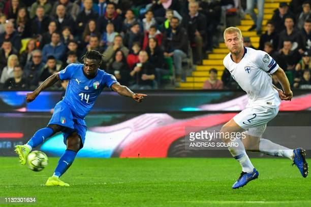 Italy's forward Moise Kean challeges Finland's defender Paulus Arajuuri during the Euro 2020 Group J qualifying football match between Italy and...