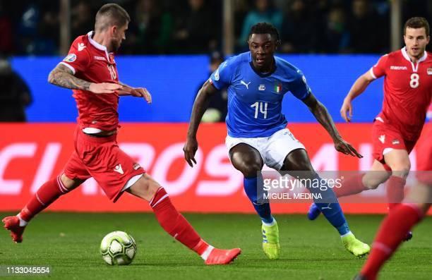 Italy's forward Moise Kean dribbles Liechtenstein's defender Sandro Wieser during the Euro 2020 Group J qualifying football match Italy vs...