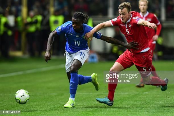 Italy's forward Moise Kean outruns Liechtenstein's defender Jens Hofer during the Euro 2020 Group J qualifying football match Italy vs Liechtenstein...