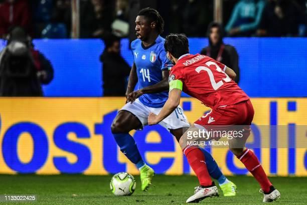 Italy's forward Moise Kean outruns Liechtenstein's midfielder Michele Polverino during the Euro 2020 Group J qualifying football match Italy vs...