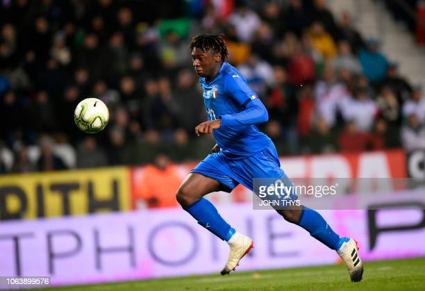 Italy's forward Moise Kean runs for the ball during the friendly football match between Italy and the USA at the Luminus Arena Stadium in Genk on...