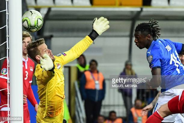 Italy's forward Moise Kean scores a header past Liechtenstein's goalkeeper Benjamin Buchel during the Euro 2020 Group J qualifying football match...