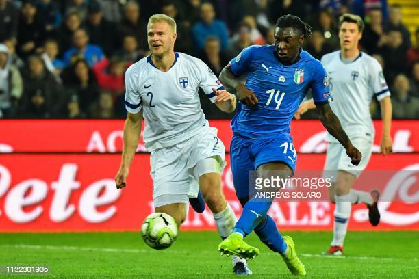 Italy's forward Moise Kean shoots to score during the Euro 2020 Group J qualifying football match between Italy and Finland on March 23 2019 at the...