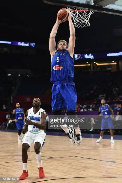 Italy's forward Nicolo Melli jumps to score a basket next to Finland's forward Jamar Wilson during their FIBA Eurobasket 2017 men's round 16...