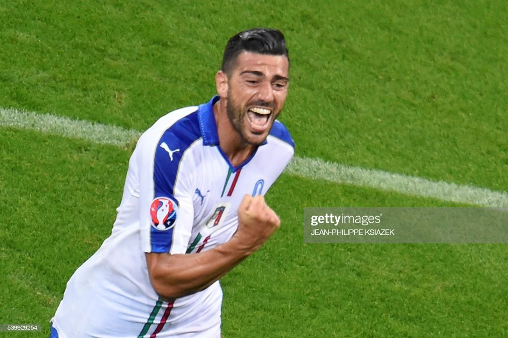 TOPSHOT - Italy's forward Pelle celebrates his team's second goal to beat belgium 2-0 in the Euro 2016 group E football match between Belgium and Italy at the Parc Olympique Lyonnais stadium in Lyon on June 13, 2016. /