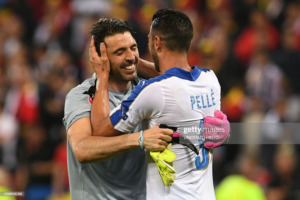 TOPSHOT - Italy's forward Pelle (R) celebrates with Italy's goalkeeper Gianluigi Buffon after scoring during the Euro 2016 group E football match between Belgium and Italy at the Parc Olympique Lyonnais stadium in Lyon on June 13, 2016. /