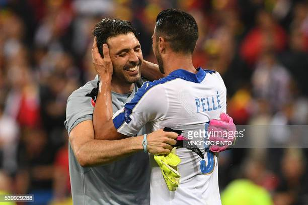 TOPSHOT Italy's forward Pelle celebrates with Italy's goalkeeper Gianluigi Buffon after scoring during the Euro 2016 group E football match between...