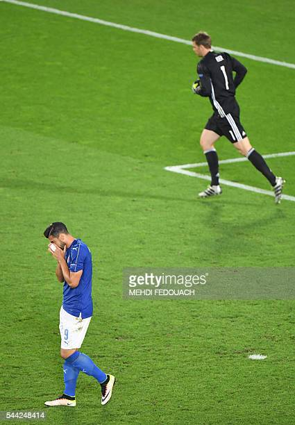 Italy's forward Pelle misses a penalty against Germany's goalkeeper Manuel Neuer during the Euro 2016 quarter-final football match between Germany...