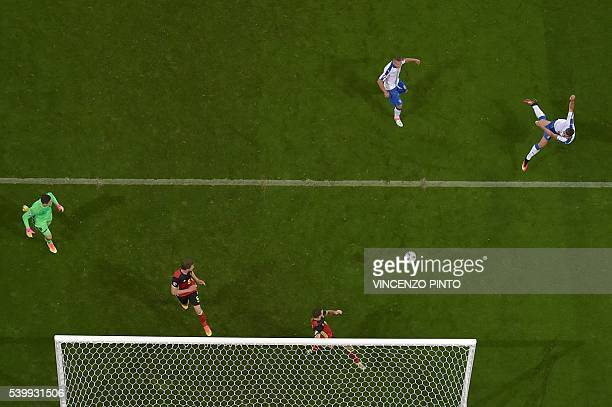 TOPSHOT Italy's forward Pelle shoots the winning goal beating Belgium 20 in the Euro 2016 group E football match between Belgium and Italy at the...