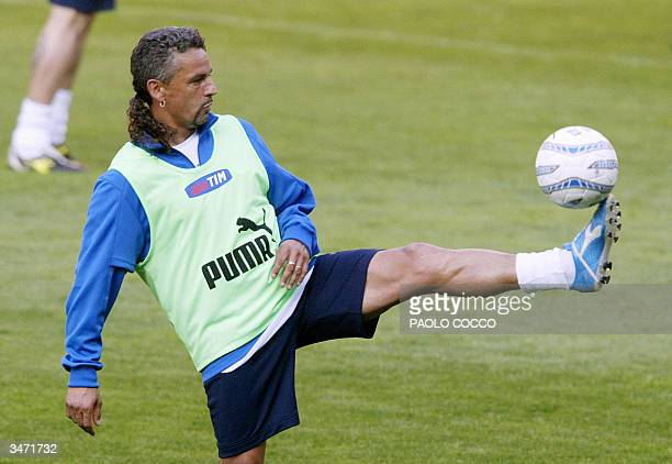 Italy's forward Roberto Baggio controls the ball during a training session at Luigi Ferraris stadium in Genoa 27 April 2004 Italy will play Spain in...