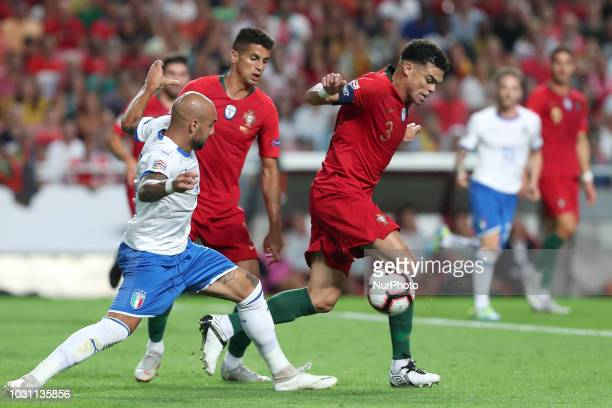 Italy's forward Simone Zaza vies with Portugal's defender Pepe during the UEFA Nations League A group 3 football match Portugal vs Italy at the Luz...