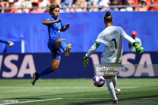 TOPSHOT Italy's forward Valentina Giacinti vies with Netherlands' goalkeeper Sari van Veenendaal during the France 2019 Women's World Cup...