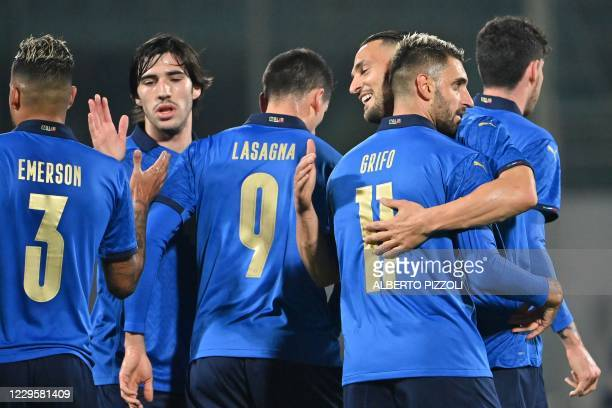 Italy's forward Vincenzo Grifo celebrates with Italy's defender Danilo DAmbrosio and Italy's midfielder Sandro Tonali after opening the scoring...