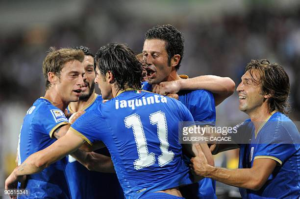 Italy's forward Vincenzo Iaquinta celebrates after scoring with Italy's defender Fabio Grosso Italy's midfielder Claudio Marchisio and Italy's...
